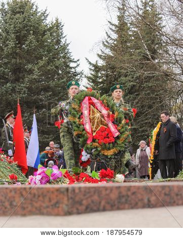 Kirishi, Russia - 9 May, Crowned group at the monument, 9 May, 2017. Laying wreaths and flowers in memory of the fallen at the Eternal Flame.
