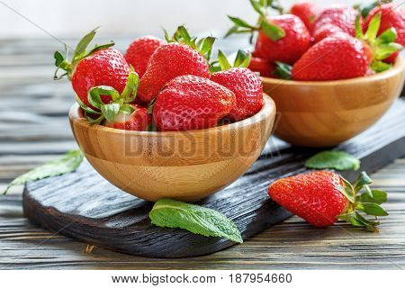 Wooden Bowl With Ripe Strawberries.