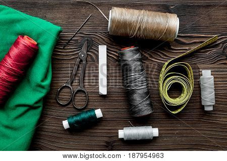 Tools for sewing and handmade for hobby set on wooden desk background top view