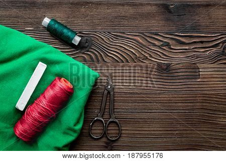tools for sewing for hobby set on wooden table background top view mock up