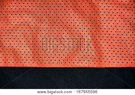 Red Sport Clothing Fabric Texture Background. Top View Of Red Cloth Textile Surface. Bright Basketba