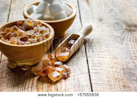 sugar cubes on kitchen wooden table background
