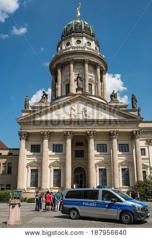 German Police Car In Front Of The French Dome At Gendarmenmarkt In Berlin