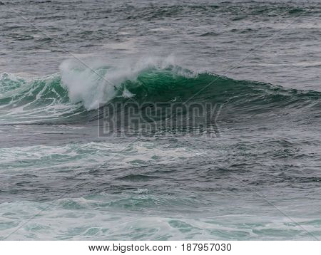 Glassy Teal Wave Rolling Over