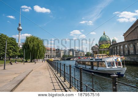 Tourist Boat On River Spree At Monbijoupark With   Berlin Cathedral And Tv Tower