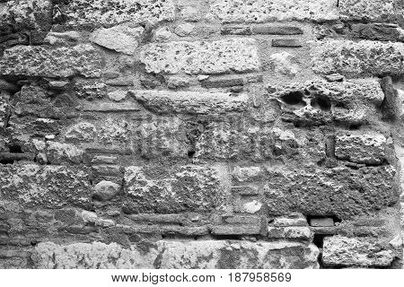 View of the stone wall of the fortress close-up background texture.