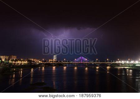 Lightning storm over Badajoz city in night