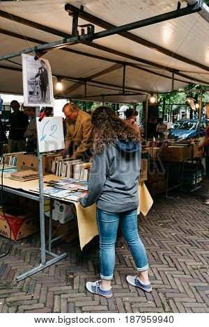 Hague Netherlands - August 7 2016: Unidentified people in a book and antiques market stall in the street of The Hague