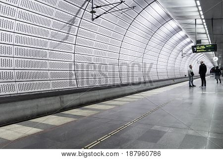 Two men at Malmo metro station Triangeln Sweden - May 17 2017