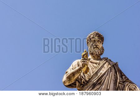 St. Peter with the keys in his hand in front of St. Peters church Rome Italy - May 2 2017
