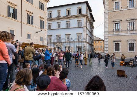 Clown performs at Piazza di Santa Maria in Trastevere Rome - May 4 2017