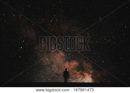 Silhouette of man on a background of stars..Man desires guess looking at the stars.
