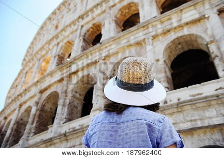 Female Traveler Looking On The Colosseum In Rome, Italy