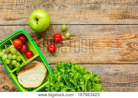 breakfast take away with lunchbox and fresh food on wooden table background top view space for text