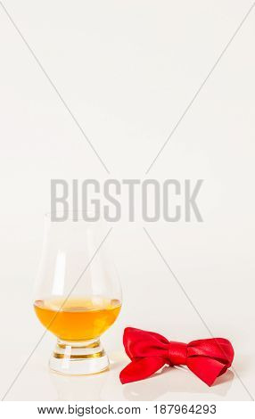 Single Malt Tasting Glass, Single Malt Whisky In A Glass, White Background, Red Bow