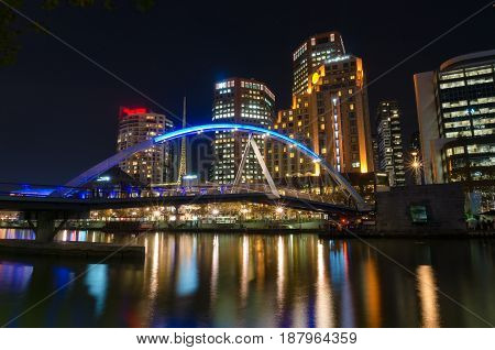 Beautiful Bridge Over River And Cityscape At Night
