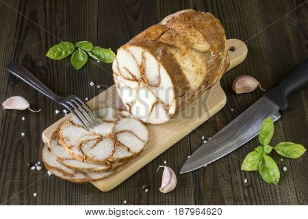 fresh homemade pork loin ham on wooden table