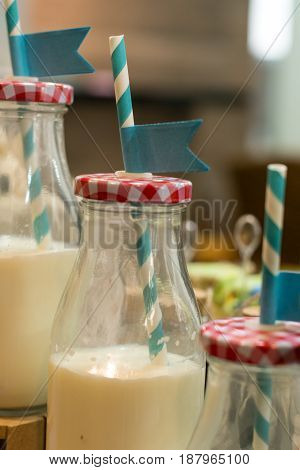 Ornaments group of sweet and candy for one year old boy. Bottles of milk compose the table