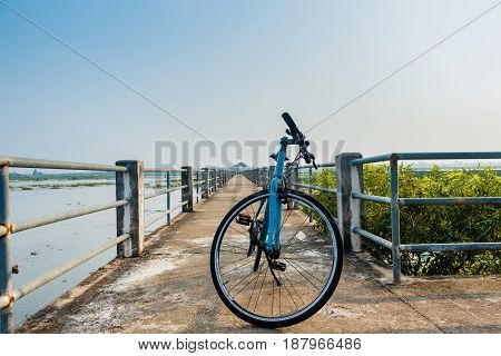 bicycle on Bridge view lake nonghan Sakon Nakhon Province Thailand