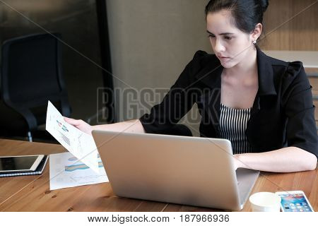 Beautiful Young Businesswoman Is Working A Presentation