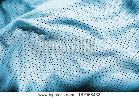 Blue Sport Clothing Fabric Texture Background. Top View Of Light Blue Cloth Textile Surface. Bright