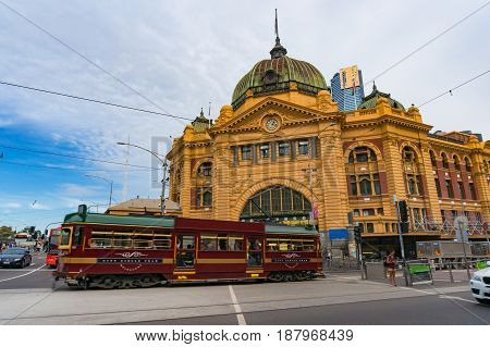 Historic Tram Passing In Front Of Flinders Street Station