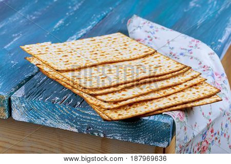 Jewish Holiday Passover Background With Matzoh On Vintage Old Wood Board.
