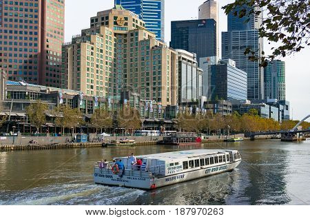 Melba Star Cruise Boat On Yarra River With Melbourne Cityscape On The Background