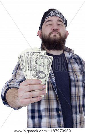 Young bearded man holding money on white background
