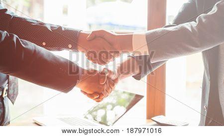 Business men shaking hands for good job