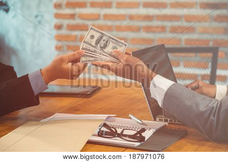 Bribes being offered in a business situation