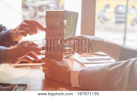 Balancing important issues at the office, concept using wooden stacked blocks