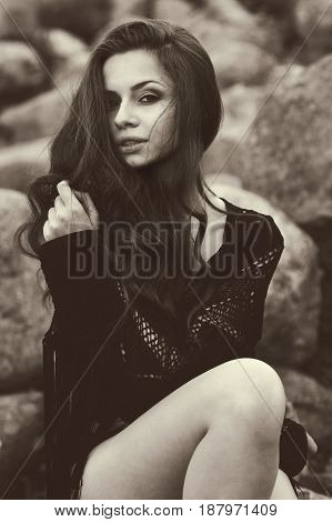 sepia colours outdoor portrair of young beautiful and sensual girl looking at you and charming you