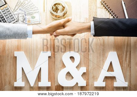 M & A (or Merger and Acquisition)