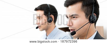 Male call center (or telemarketer) team - panoramic banner