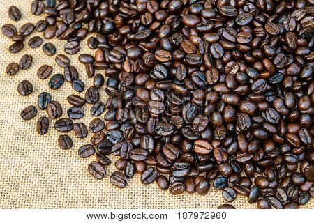 Roasted coffee beans on a sack background
