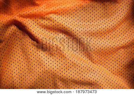 Orange Sport Clothing Fabric Texture Background. Top View Of Orange Cloth Textile Surface. Bright Ba