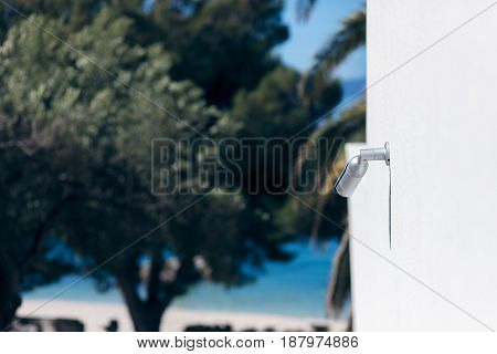 surveillance camera above a beach in hotel resort