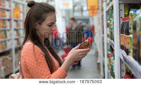 girl buys lemonade in a food store