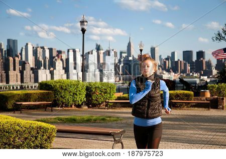Woman Runner Is Jogging On View Of Downtown Manhattan