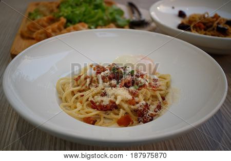 Spaghetti is made from wheat flour. And a little larger than the noodles.