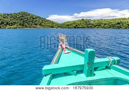 Front of ship nose heading to the island in turquoise sea and blue sky of koh Mak (Mak island) Trat Thailand.
