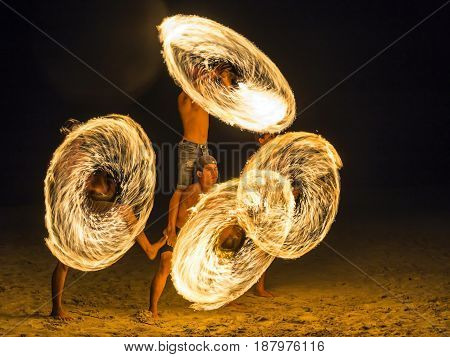 Trat Thailand - May 10th 2017; 4 men Show spinning fire on the beach of Koh Chang (Chang island) at night.