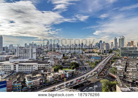 Bangkok Thailand - May 15 2017: Business area in Na Ranong 5 intersection and express way with blue sky and clouds background in Bangkok Thailand