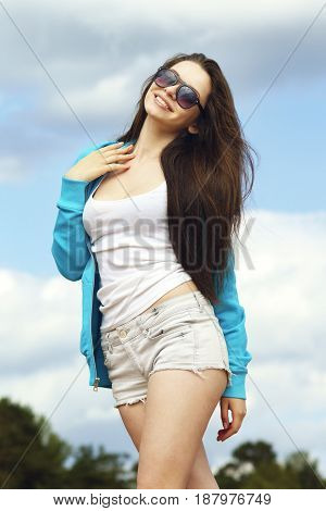 young beautiful girl in casual clothes at the beach