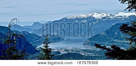 Idyllic views of the ocean,  mountains and islands. Panorama of a little city by the ocean among mountains. Squamish. Whistler. Vancouver. British Columbia. Canada.