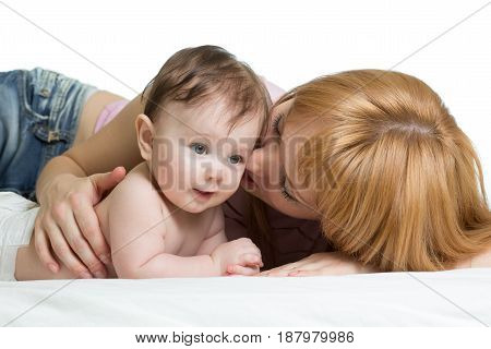 Cute mother kissing her little baby boy