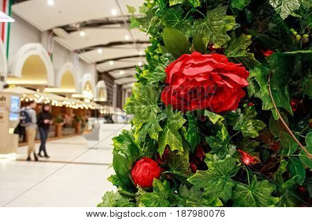 Red beautiful flowers made of cloth used as interior decoration in shopping center
