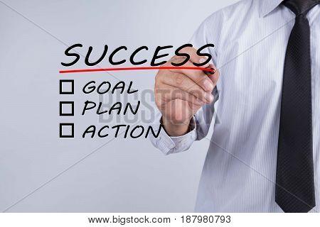 Businessman hand writing success Business concept. goal, plan, action
