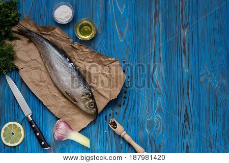 Ingredients for cooking fish: salt oil spices garlic lemon and herbs. Top view